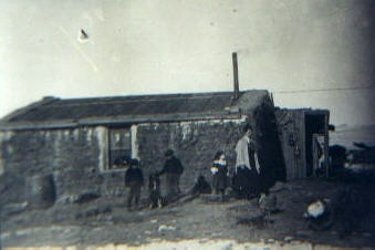 The Woodland family outside their first soddie north of Clark, South Dakota