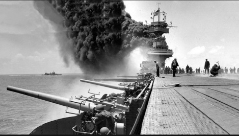 U.S.S. Yorktown on fire after bombing - wikimedia.com